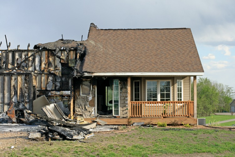 Home with half severely damaged by fire